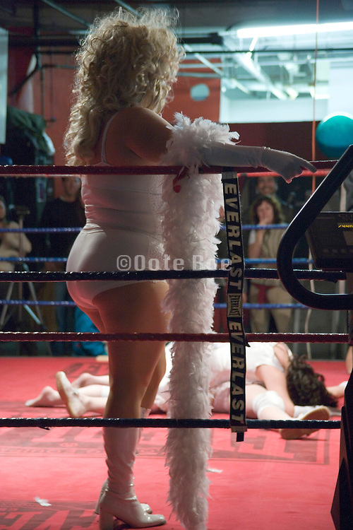 a performance of woman wrestling in a boxing ring