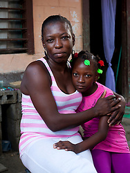 "The Garifuna, a group of Afro-Carribean descendants of West African slaves, live on the Caribbean coast of Honduras.  They have their own language and a rich tradition of dance and music. They also have one of the highest HIV rates in the western hemisphere, according to the Inter-American Development Bank. At 4.5%, they have a rate that is five times what the national rate in Honduras is. Over the past 10 years medicines have become more widely available and access to health care has improved.  There are still obstacles to HIV treatment and prevention, but there are not scores of Garifuna dying due to lack of treatment.  ..Currently, one of the biggest problems that the population faces is the stigma and discrimination that people living with HIV feel.  There is still a lack of education and awareness about the disease that leads to newly diagnosed people being ostracized by their friends and family and unable to find work.  Some people fall into a deep depression and consider suicide, and others simply deny their diagnosis and refuse to see a doctor or take any medication. Because of this strong stigma, many Garifuna are afraid to make their HIV status publicly known and live in the shadows, keeping secrets from their family and community. But there are some people who have stood up in the face of discrimination and chosen to make their HIV status publicly known. They have set an example to everyone in their towns and, simply by living publicly, are helping to break down stigma and fight discrimination...The following are portraits of some of these people....Lesbia Martinez, 33, with her daughter Asly Carolina Cordaba, 8. Lesbia was ostracized by her family when she told them about her HIV diagnosis and once tried to kill herself. Now she says that she wants to be an example in her community and ""keep her head high and continue moving forward""."