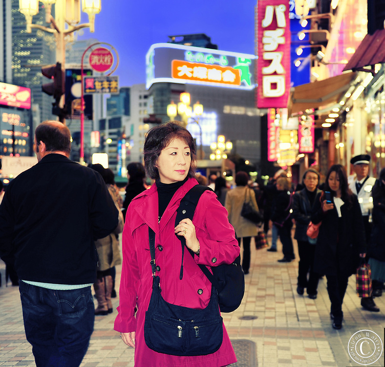 A busy night street in Shinjuku, Tokyo Japan.
