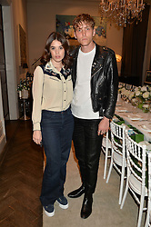 GALA GORDON and NATHAN MITCHELL at the Creme de la Mer Blue Marine Foundation Dinner held at The Arts Club, 40 Dover Street, London on 23rd June 2015.