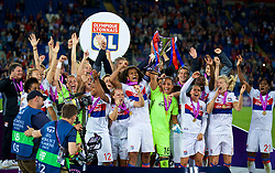 CARDIFF, WALES - Thursday, June 1, 2017: Olympique Lyonnais' Wendie Renard lifts the trophy as her side celebrate winning the UEFA Champions League during the UEFA Women's Champions League Final between Olympique Lyonnais and Paris Saint-Germain FC at the Cardiff City Stadium. (Pic by David Rawcliffe/Propaganda)