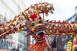 © Licensed to London News Pictures. 14/02/2016. London, UK.   Dancers perform a dragon dance as part of the Chinese New Year parade around Chinatown celebrating the Year of the Monkey. Photo credit : Stephen Chung/LNP