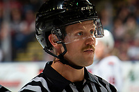 KELOWNA, BC - NOVEMBER 16: Linesman Dustin Minty stands on the ice at the Kelowna Rockets against the Kamloops Blazers at Prospera Place on November 16, 2019 in Kelowna, Canada. (Photo by Marissa Baecker/Shoot the Breeze)