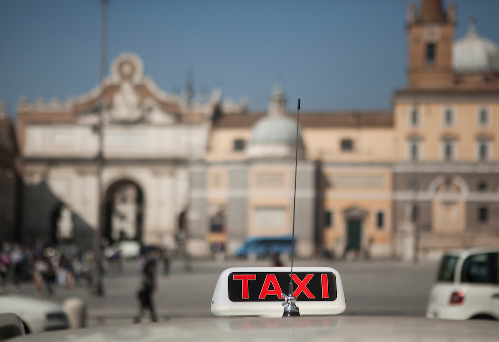 Taxis at Piazza del Popolo in Rome, Italy.