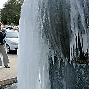 A student photographs a frozen fountain at Troy University in Troy, Ala., Tuesday, Jan. 7, 2014. (Photo/Thomas Graning)