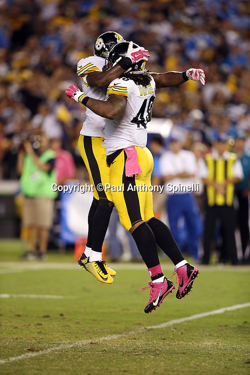 Pittsburgh Steelers linebacker Bud Dupree (48) leaps and celebrates with Pittsburgh Steelers inside linebacker Lawrence Timmons (94) after Dupree sacks the quarterback for a loss of 4 yards in the third quarter during the 2015 NFL week 5 regular season football game against the San Diego Chargers on Monday, Oct. 12, 2015 in San Diego. The Steelers won the game 24-20. (©Paul Anthony Spinelli)