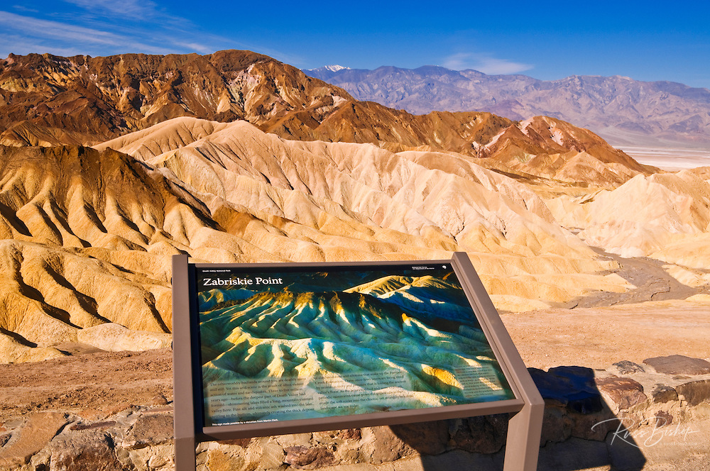 Interpretive sign and eroded hills at Zabriskie Point, Death Valley National Park. California