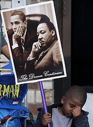 January 16, 2017 - Los Angeles, California, U.S - A boy hold a signs with pictures of President Obama and  Martin Luther King Jr. in the 32nd annual Kingdom Day Parade. The parade is Southern California's largest Martin Luther King Jr. Day observance. The theme of this year's parade was ''Now More Than Ever, We All Must Work Together. (Credit Image: © Ringo Chiu via ZUMA Wire)