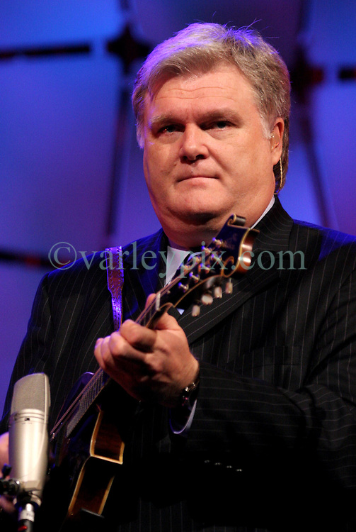 March 12th, 2006. New Orleans, Louisiana. <br /> Legendary Blue Grass musician Ricky Skaggs plays to the crowd before the Rev Billy Graham takes the stage. Claiming this to be his last event preaching from the pulpit, the world's most famous evangelist, The Reverend Billy Graham later addressed a capacity crowd at the New Orleans Arena as he brings his 'Celebration of Hope' weekend event to an end.<br /> Photo&copy;; Charlie Varley/varleypix.com