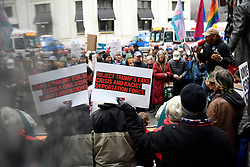 An estimated 175 protestor gathered at the South apron of City Hall to protest President Trumps National Emergency call, during a President's Day protest, on Monday. (Bastiaan Slabbers for WHYY)
