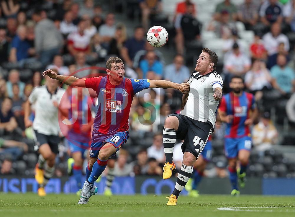 Ross McCormack of Fulham is challenged by James McArthur of Crystal Palace - Mandatory by-line: Paul Terry/JMP - 07966386802 - 01/08/2015 - SPORT - FOOTBALL - Fulham,England - Craven Cottage - Fulham v Crystal Palace - Pre-Season Friendly