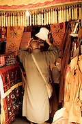 a monk tries on a hat,Mt.Putuo