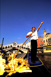 Venice, Italy: A gondolier tries to lure a customer into his craft for a guided tour of Venice's famous canals.
