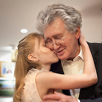 Katrin Kristjansdottir kisses her grandfather Gunnar Eyjolfsson as he arrives from Christmas dinner in Reykjavik, Iceland on December 25, 2013.