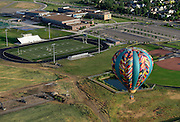 A balloon is seen near Frederick High School on Friday. Frederick in Flight runs Saturday June 25 and 26 and features a hot air balloon lift offs, live music, food vendors, a beer and wine garden, activities for kids and hot air balloons candle-sticking and glowing.<br /> Matthew Jonas/Staff Photographer June 24, 2016