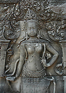 This Apsara bas-relief is from Angkor Wat, the world's largest single religious monument, built for the king Suryavarman II in the early 12th century as his state temple and capital city. <br />  <br /> The ruins of Angkor, a UNESCO World Heritage Site with temples numbering over 1000, are hidden amongst forests and farmland to the north of the Tonle Sap Lake outside the modern city of Siem Reap, Cambodia. <br /> <br /> Angkor Wat has remained a significant religious centre since its foundation--first Hindu, dedicated to Vishnu, then Buddhist. Quite a few of the temples at Angkor have been restored and represent a significant site of Khmer architecture.  Angkor Wat has become a symbol of Cambodia, appearing on its national flag and is worthy of all it's attention. <br /> <br /> It is one of the most awe-inspiring locations I have ever been. From the sunrise to the sunset, there isn't a time of day that is not simply a spectacular time to explore this breathtaking location.