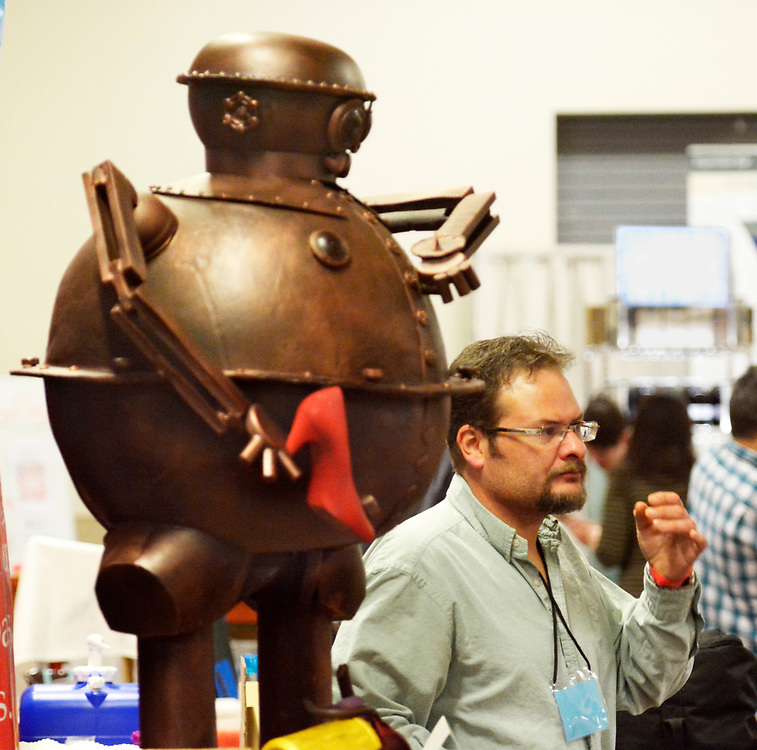 """gbs032617f/ASEC -- Chocolatier Troy Lapsys. owner of Joliesse Chocolates in Los Ranchos de Albuquerque, with his 140 lbs chocolate sculpture  """"Tik-Tok of Oz"""" he made, at his booth at the Southwest Chocolate & Coffee Fest at the Expo NM State Fairgrounds on Sunday, March 26, 2017. (Greg Sorber/Albuquerque Journal)"""