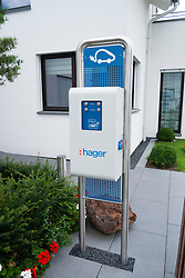 Electric car charging station in modern highly energy efficient family house  in Germany
