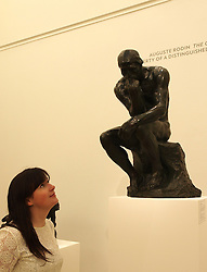 A visitor looks at August Rodin's 'Le Penseue' (The Thinker) estimated at U.S. $ 8-12 million is going on sale in New York on May 7-8, 2013.  Photo taken in London, Friday April 12, 2013. Photo by Max Nash / i-Images.