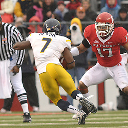 Dec 5, 2009; Piscataway, NJ, USA; Rutgers linebacker Damaso Munoz (17) tracks West Virginia running back Noel Devine (7) during first half NCAA Big East college football action between Rutgers and West Virginia at Rutgers Stadium.