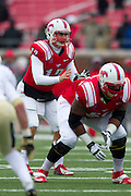 DALLAS, TX - DECEMBER 7: Neal Burcham #12 of the SMU Mustangs reads the defense against the Central Florida Knights on December 7, 2013 at Gerald J. Ford Stadium in Dallas, Texas.  (Photo by Cooper Neill) *** Local Caption *** Neal Burcham