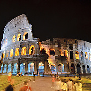 A night shot of the famous Roman ruins of the Coliseum in Rome, Italy, at night.