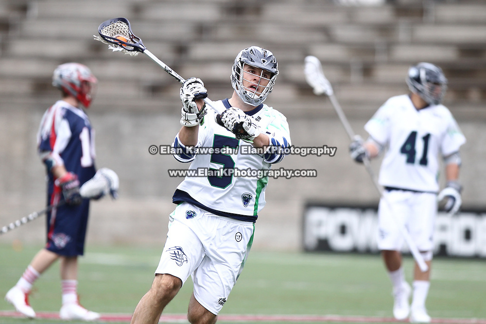 Kyle Dixon #5 of the Chesapeake Bayhawks controls the ball during the game at Harvard Stadium on April 27, 2014 in Boston, Massachusetts. (Photo by Elan Kawesch)