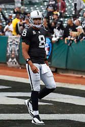 Sep 25, 2011; Oakland, CA, USA;  Oakland Raiders quarterback Jason Campbell (8) warms up before the game against the New York Jets at O.co Coliseum. Oakland defeated New York 34-24.