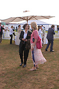 Bianca Jagger and Sabrina Guinness. Cartier International Day at Guards Polo Club, Windsor Great Park. July 24, 2005. ONE TIME USE ONLY - DO NOT ARCHIVE  © Copyright Photograph by Dafydd Jones 66 Stockwell Park Rd. London SW9 0DA Tel 020 7733 0108 www.dafjones.com