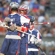 Stephen Berger #10 of the Boston Cannons and Will Manny #1 of the Boston Cannons celebrate a goal during the game at Harvard Stadium on August 9, 2014 in Boston, Massachusetts. (Photo by Elan Kawesch)