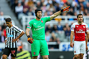 Petr Cech (#1) of Arsenal issues instructions at a corner during the Premier League match between Newcastle United and Arsenal at St. James's Park, Newcastle, England on 15 September 2018.