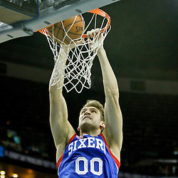 November 7, 2012; New Orleans, LA, USA; Philadelphia 76ers center Spencer Hawes (0) dunks against the New Orleans Hornets during the second half of a game at the New Orleans Arena. The 76ers defeated the Hornets 77-62. Mandatory Credit: Derick E. Hingle-US PRESSWIRE