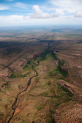 An aerial landscape view of rugged and remote terrain in the east Kimberley .