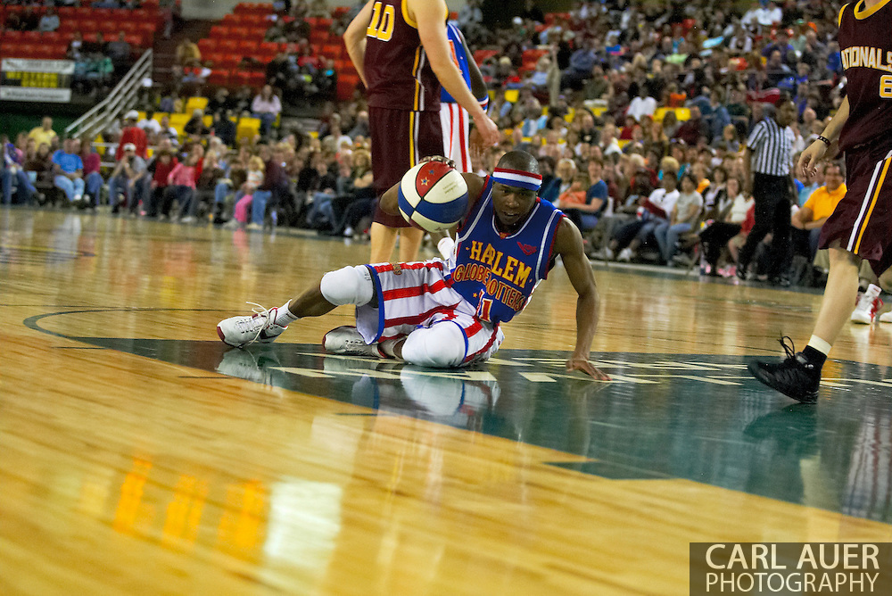 05 May 2006: Keiron 'Sweet P' Shine shows off his ball handling skills sliding all over the cour during the Harlem Globetrotters game vs the New York Nationals at the Sulivan Arena in Anchorage Alaska during their 80th Anniversary World Tour.