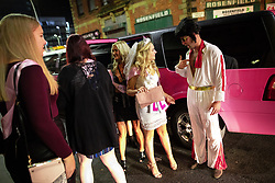 © Licensed to London News Pictures . 27/10/2018. Manchester, UK. Elvis Presley outside the Printworks in Manchester City Centre . Revellers on a night out , many in fancy dress , on the weekend before Halloween . Photo credit: Joel Goodman/LNP