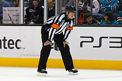 Dec 23, 2011; San Jose, CA, USA; NHL referee Dave Jackson (8) before a face off between the San Jose Sharks and the Los Angeles Kings during the first period at HP Pavilion. San Jose defeated Los Angeles 2-1 in shootouts. Mandatory Credit: Jason O. Watson-US PRESSWIRE