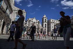 November 23, 2016 - Havana, Cuba - Tourist walking in Catedral´s plaza with the principal church in Havana, Cuba, on 23 November 2016. (Credit Image: © Alvaro Fuente/NurPhoto via ZUMA Press)