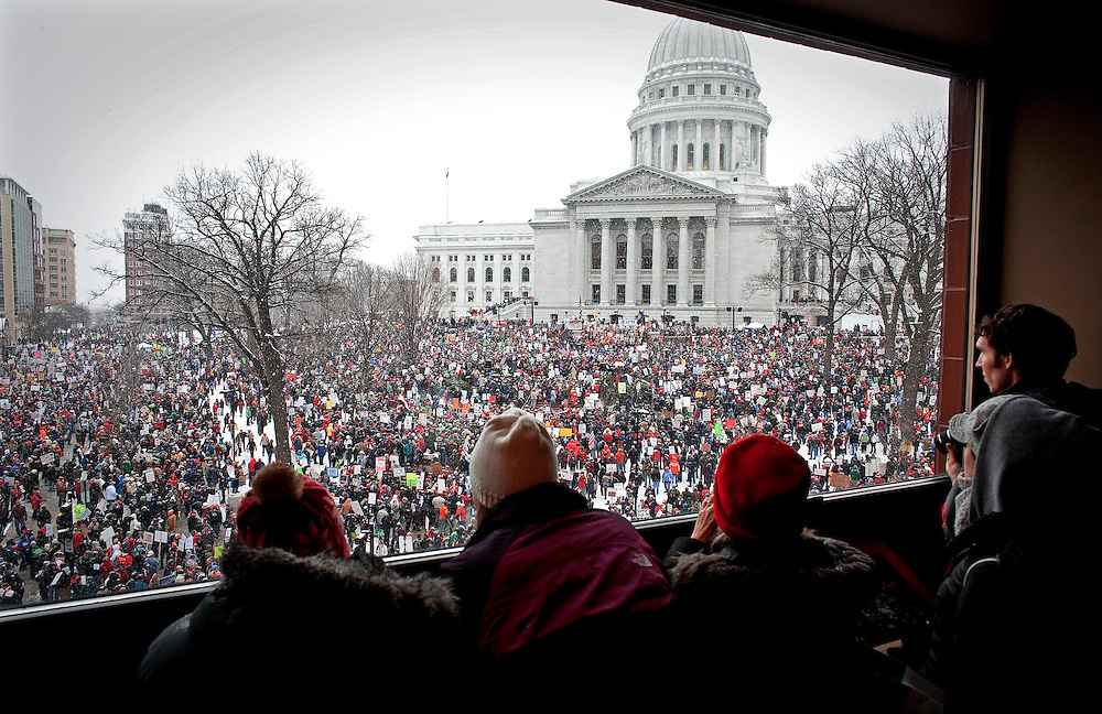 A birds eye view of thousands of protesters outside of the Wisconsin State Capitol.