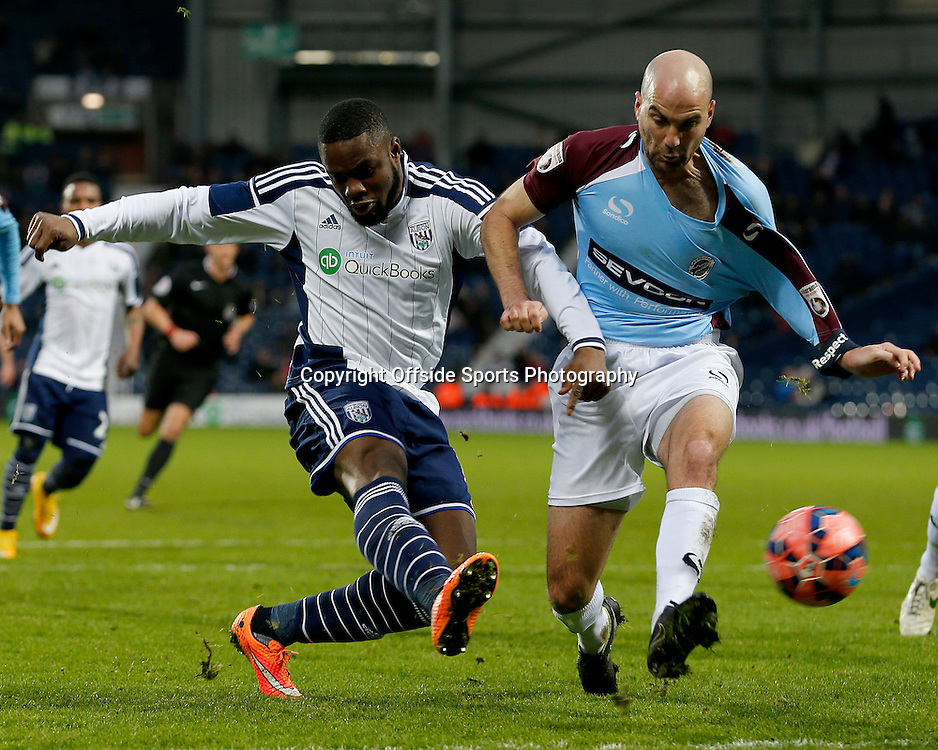 3rd January 2015 - FA Cup 3rd Round - West Bromwich Albion v Gateshead - Victor Anichebe of West Bromwich Albion fires past Ben Clark of Gateshead to extend the lead (2-0) - Photo: Paul Roberts / Offside.