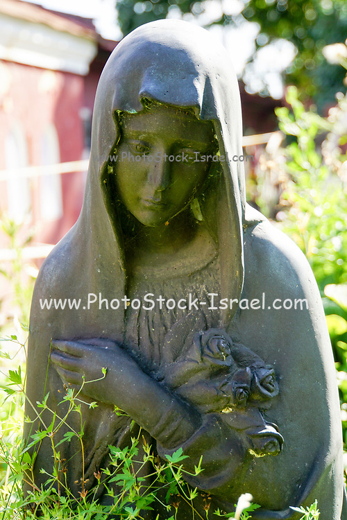 Grieving woman statue at Novodevichy Cemetery, Moscow, Russia