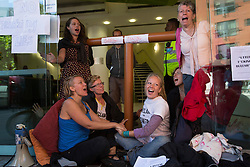 © licensed to London News Pictures. London, UK 19/08/2013. A group of anti-fracking protesters superglue themselves to the entrance of Bell Pottinger PR company in Holborn, London to protest against the fracking in Balcombe. Photo credit: Tolga Akmen/LNP