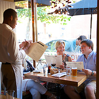 Diners order their food with a waiter at Mintwood Place restaurant in the Adams Morgan neighborhood of Washington, DC.