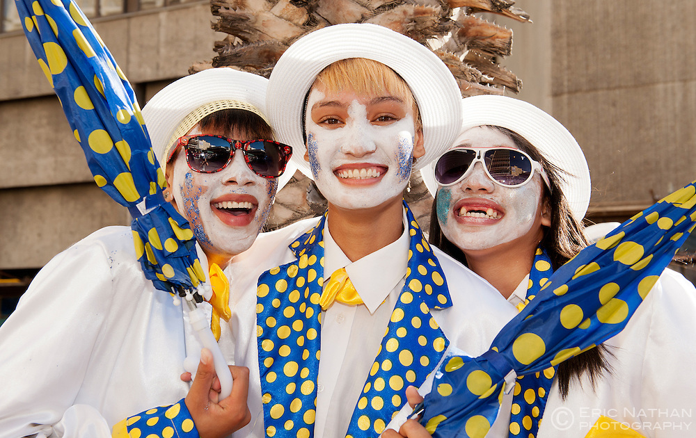 Three girls taking part in the Cape Minstrels parade in Cape Town, South Africa.