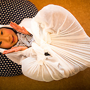 """TOKYO, JAPAN - JANUARY 29 : Participant wrapped in a white cloth during a workshop called """"Otonamaki"""", which directly translates to adult wrapping, Tokyo, Japan on Sunday, January 29, 2017. Otonamaki is a Japanese therapeutic method meant to alleviate posture problems and stiffness. (Photo by Richard Atrero de Guzman/ANADOLU Agency)"""