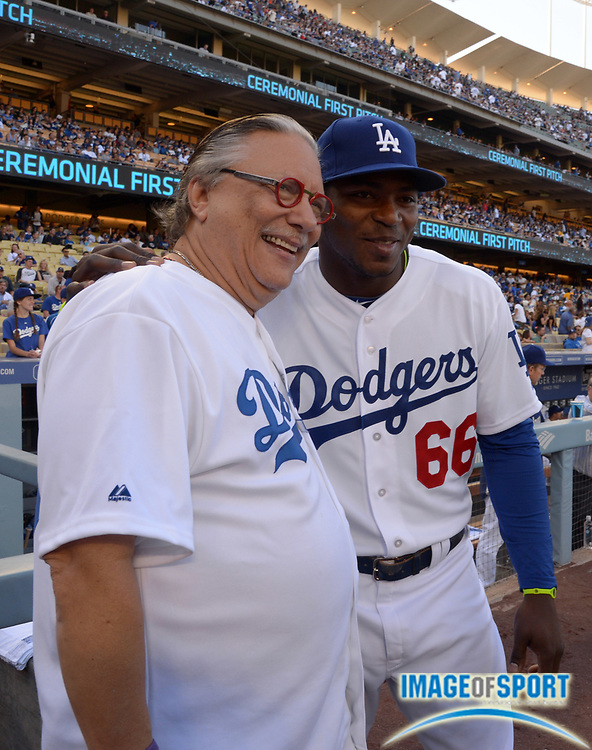 Apr 6, 2014; Los Angeles, CA, USA; Los Angeles Dodgers right fielder Yasiel Puig (66) poses with entertainer and jazz trumpeter Arturo Sandoval before the game against the San Francisco Giants at Dodger Stadium.
