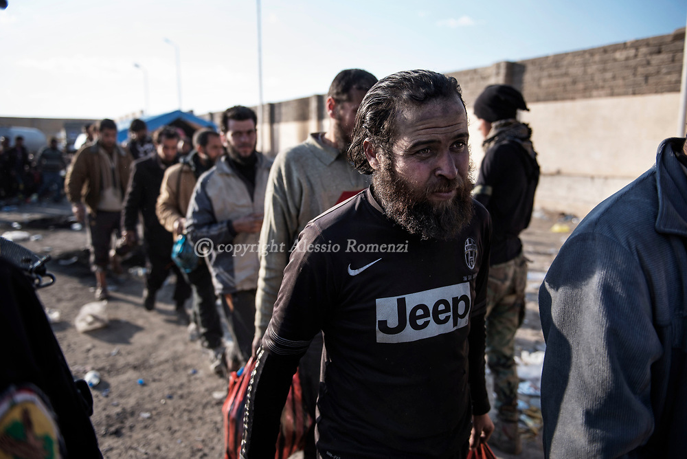 Iraq, Mosul: Before to be transferred to IDP camps civilians who escaped Mosul are gathered in a facility in the outskirts of west Mosul. In this occasion the Iraqi army makes a first screening to identify potential ISIS members who trying to escape blending among civilians. Alessio Romenzi