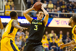 Feb 6, 2016; Morgantown, WV, USA; Baylor Bears guard Jake Lindsey (3) looks to pass around West Virginia Mountaineers defenders during the first half at the WVU Coliseum. Mandatory Credit: Ben Queen-USA TODAY Sports