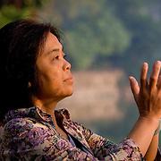 Woman praying to early morning sun in Hanoi (Hanoi, Vietnam - Nov. 2008) (Image ID: 081117-0720221a)