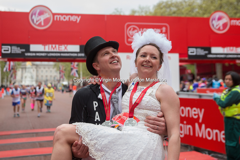 Paul Elliott and Laura Harvey celebrated their marriage after running the first half of the Virgin Money London Marathon.They went on to run the remainder of the race as husband and wife before they could enjoy their wedding reception, Sunday 26th April 2015.<br /> <br /> Scott Heavey for Virgin Money London Marathon<br /> <br /> For more information please contact Penny Dain at pennyd@london-marathon.co.uk