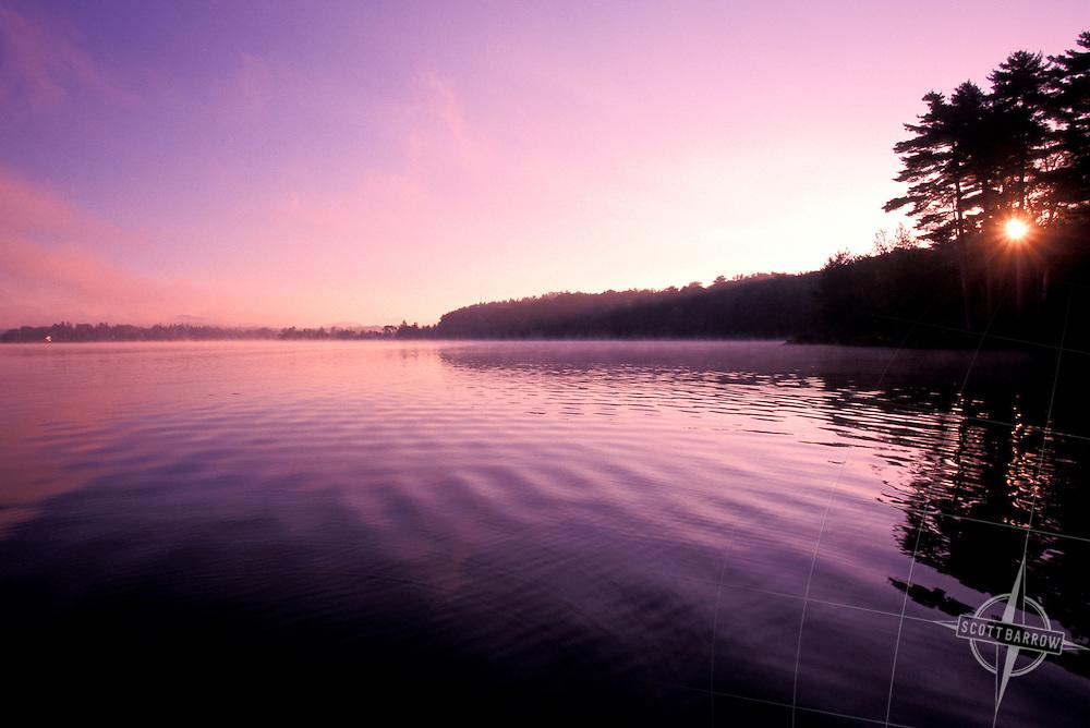 Fog at dawn over lake.